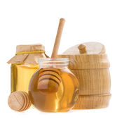Glass pot of honey and stick — Stock Photo
