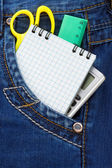 Notebook and pencil in jeans — Stock Photo