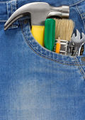 Tools and instruments in jeans — Stock Photo