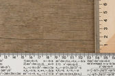 Rulers on wooden background — Stock Photo