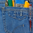 Tools and instruments in blue jeans — Stock Photo #10913073