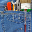Tools in old blue jeans pocket — Stock Photo #10913696