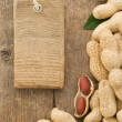 Nuts peanuts fruit and tag price on wood background - Foto de Stock  