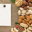 Set of nuts fruit and tag label on wood - Stock Photo