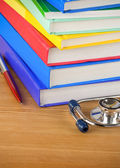 Medical stethoscope with book — ストック写真