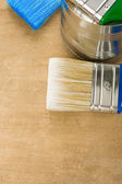 Paintbrush and can on wood — Stock Photo