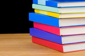 Pile of books isolated on black — Stock Photo