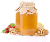 Glass jar full of honey and fruit — Stock Photo
