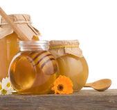 Honey in jar isolated on white — Stock Photo