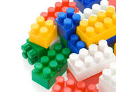 Colorful plastic toys on white background — Stock Photo