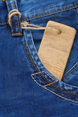 Price tag and jeans in pocket — Stock Photo
