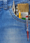 Tools and instruments in blue jeans — Stock Photo