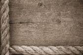 Ship ropes borders on wood background — Stock Photo