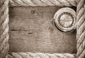 Ship ropes and compass with pen on old vintage — Stock Photo