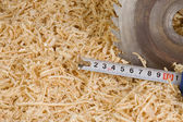 Tape measure on wood sawdust — Stock Photo