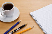 Notepad and pens on table — Stock Photo