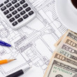 Cup of coffee, dollars and pens on drafting — Stockfoto