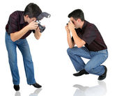 Man and camera at white background — Stock Photo