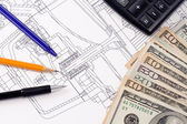 Dollars and pens on drafting of coupling — Stock Photo