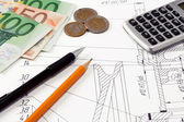 Calculator, pens and euros — Stock Photo