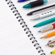 Pens and pencils on pad — Stock Photo