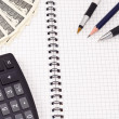 Pens, calculator and dollars — Stockfoto
