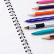Pens and pencils with pad — Stock Photo