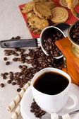 Coffee pot, sweets, cup and grinder — Stock Photo