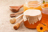 Glass jar and honey — Stock Photo
