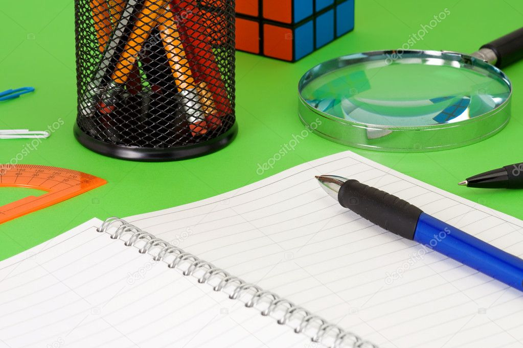 Pens near pad and pensils in basket — Stock Photo #11076824
