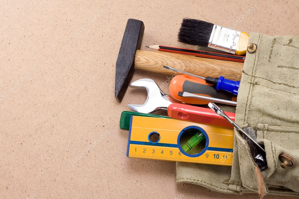 Construction tools and bag on wood texture — Stock Photo #11076865