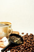 Coffee beans and glass — Stock Photo
