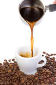 Hand outpouring coffee in cup — Stock Photo