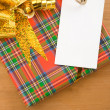 Gift box with ribbon and tag price — Stock Photo
