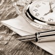 Ink pen and watch on wood — Stock Photo #11571780