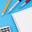Pen, pencil and calculator with pad — Stock Photo #11624137