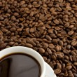 Cup of coffee on beans — Stok fotoğraf