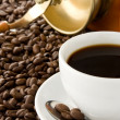 Stockfoto: Cup of coffee and grinder on beans
