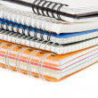 Pile of checked notebook isolated on white — ストック写真