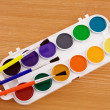 Painters palette with brush - Stock Photo