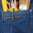 Tools and instruments in blue jeans - Stock Photo
