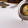 Silver compass, coin and notebook — Stock Photo