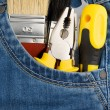 Tools and instruments in jeans pocket — Stock Photo #11624464