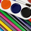 Painters palette and brush on pencils — Stock Photo #11624505