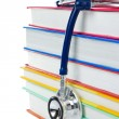 Pile of books and stethoscope isolated on white — Stock Photo #11624674