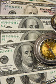 Gold compass on dollars — Stock Photo