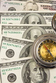 Old compass on dollars — Stock Photo