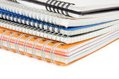Pile of checked notebook isolated on white — Stock Photo