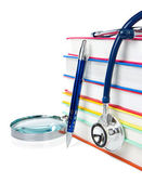 Books, pen and stethoscope isolated on white — Stock Photo