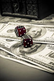 Dices on dollars — Stock Photo